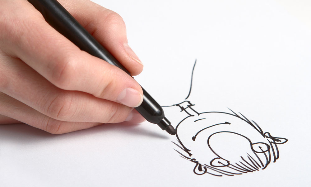 Artist drawing a cartoon.
