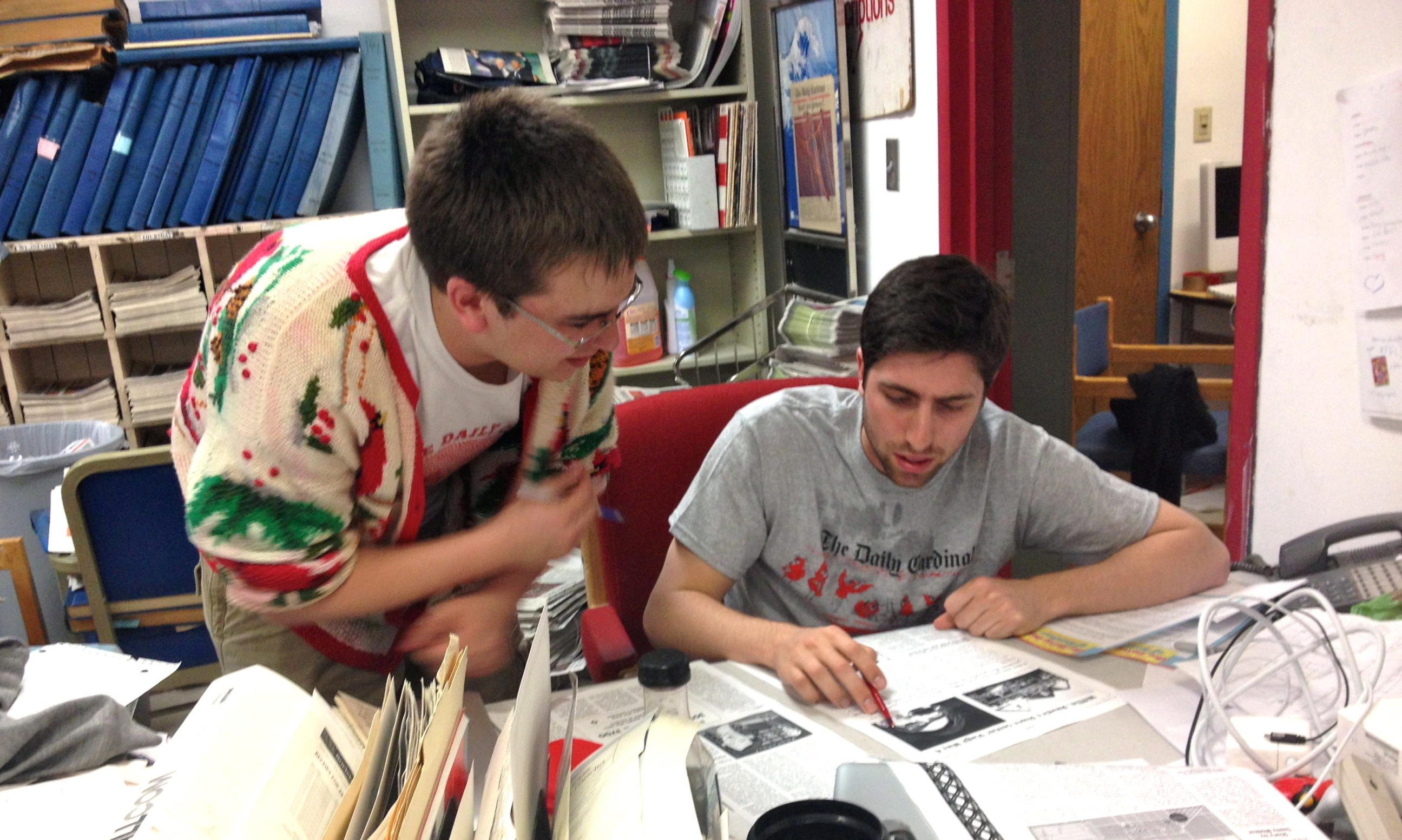 Former editor-in-chief Scott Girard and former managing editor Alex DiTullio look over the final pages of the Daily Cardinal, one of the University of Wisconsin-Madison's independent student newspapers.