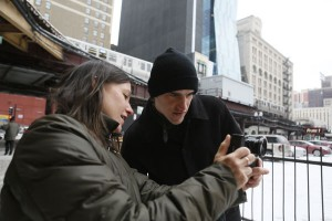 Jackie Spinner shows student Alex Wroblewski a smartphone photo app during a photojournalism class at Columbia College Chicago on a day when it was so cold the students' smartphones shut off. CREDIT: Charles Osgood.