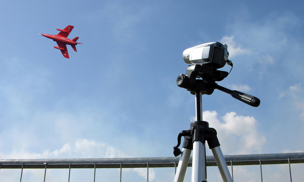 Camcorder being used at an air show.