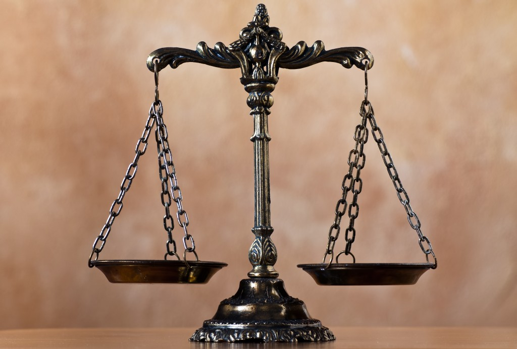 Scales of justice. Shutterstock/MilousSK