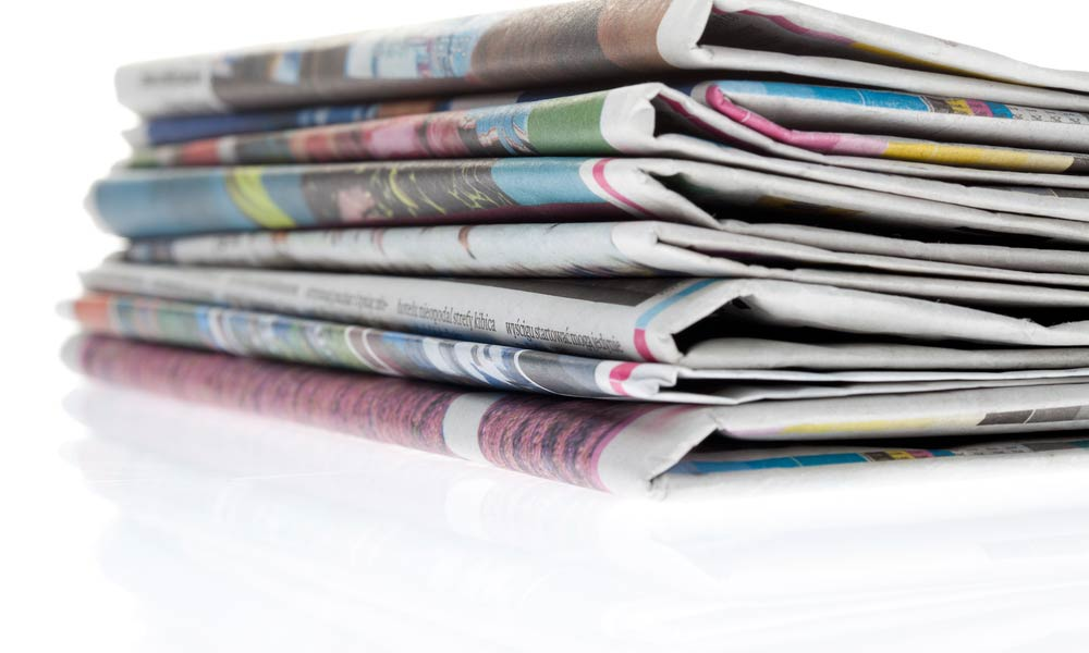 newspaper-stack-shutterstock