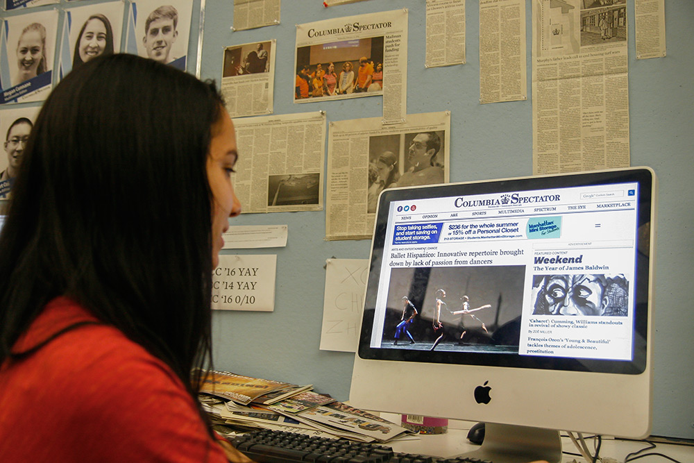 Nicole Santoro, a junior at Columbia University and staff member of the  student-run Columbia Daily Spectator, looks at the online edition.