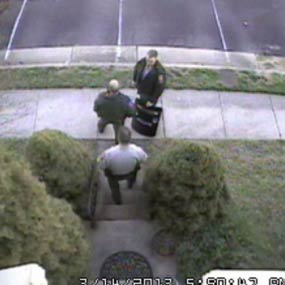 "Security camera footage of law enforcement officials at the doorstep of Brian Krebs's home in the ""Swating"" incident."