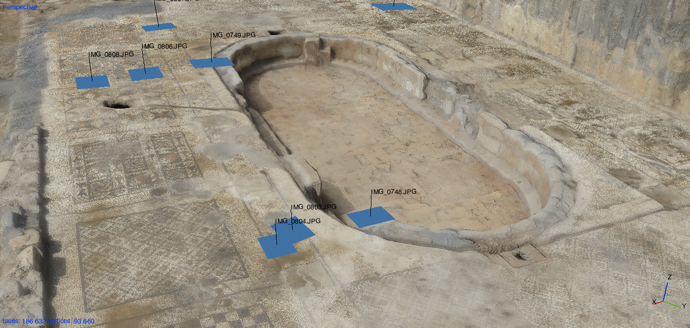 A still image of the 3D model of the archaeological site that was created from the 2,800 aerial photos captured by the drone-camera rig.  The blue squares (and captions) indicate the location (and filename) of individual photos captured during the flight.