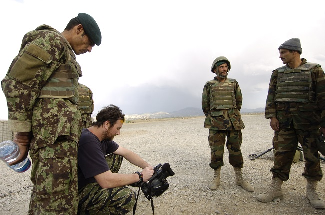 Bill Putnam, an American freelance journalists, shoots video of Afghan soldiers at Forward Operating Base Boris, Paktika province, Afghanistan, June 12, 2010.