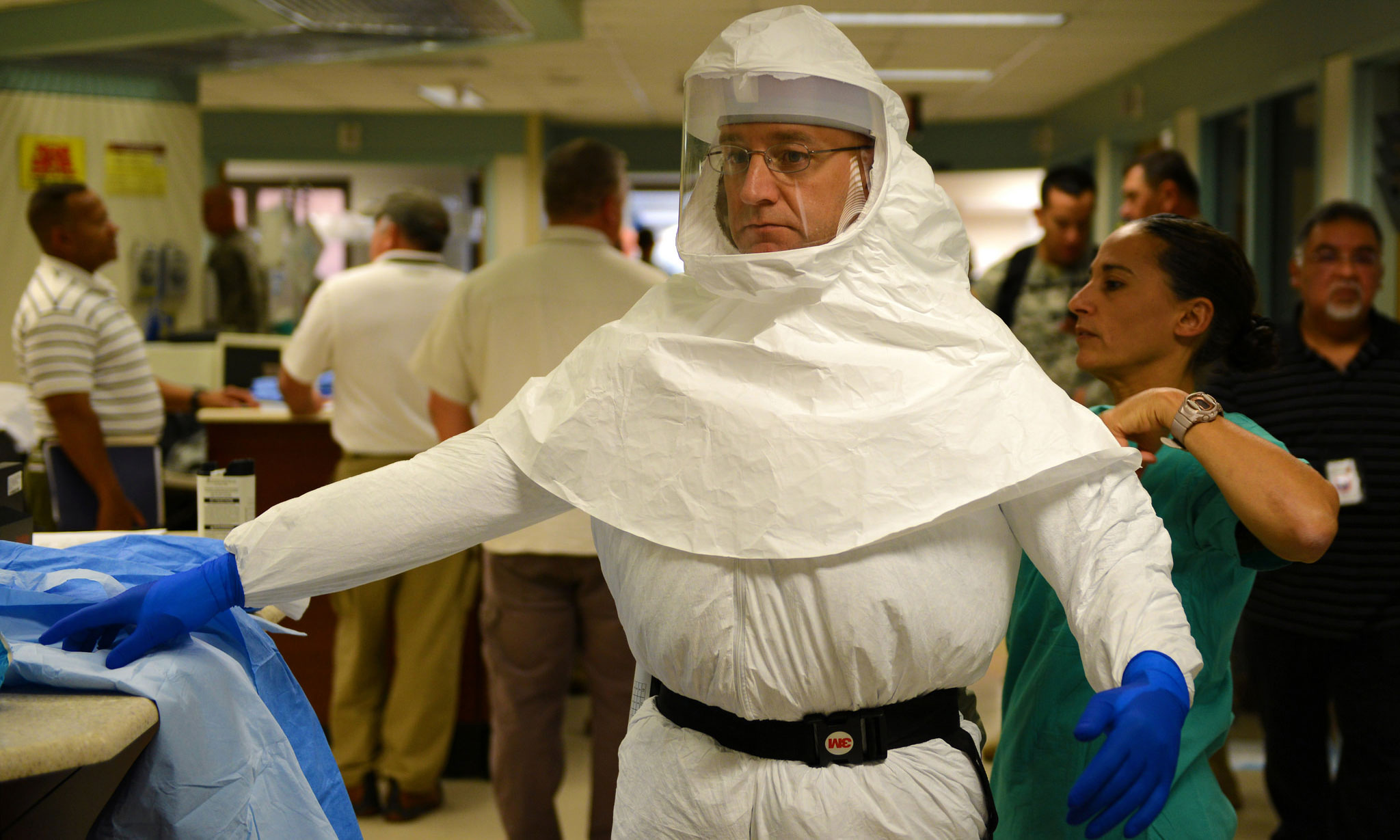 Students prepare for the next phase of Ebola response training at the San Antonio Military Medical Center in San Antonio, Texas, Oct. 24, 2014. The students are part of a 30-person medical support team designated for prepare to deploy in the event of an Ebola crisis in the U.S. DoD photo by Army Sgt. 1st Class Tyrone C. Marshall Jr, via Creative Commons license on Flickr.